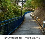 footpath and bike path along... | Shutterstock . vector #749538748