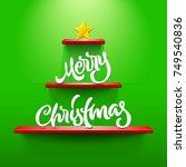merry christmas lettering on... | Shutterstock .eps vector #749540836