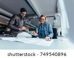 team of architects working on... | Shutterstock . vector #749540896