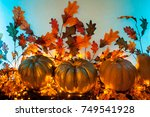 three pumpkins on a blue... | Shutterstock . vector #749541928