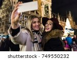 women taking a selfie at... | Shutterstock . vector #749550232