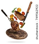 flying beef steaks with grilled ... | Shutterstock . vector #749562922