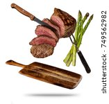 flying beef steaks with grilled ... | Shutterstock . vector #749562982