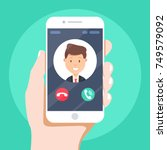incoming call on smartphone... | Shutterstock .eps vector #749579092