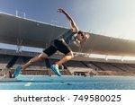 runner using starting block to... | Shutterstock . vector #749580025