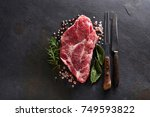 pork meat with herbs and spices | Shutterstock . vector #749593822
