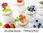 fresh yogurt with berries in... | Shutterstock . vector #749622922