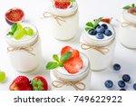 fresh yogurt with berries in... | Shutterstock . vector #749622922