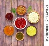sauces set on a wooden... | Shutterstock . vector #749624506