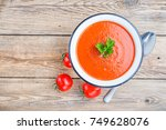 tomato soup on wooden table ... | Shutterstock . vector #749628076