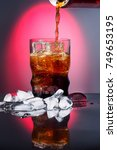 cola in drinking glass with ice ... | Shutterstock . vector #749653195