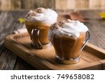 pumpkin spice latte topped with ... | Shutterstock . vector #749658082