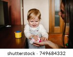 mom with little girl playing in ... | Shutterstock . vector #749684332
