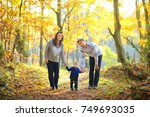 happy family walking in... | Shutterstock . vector #749693035