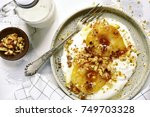 caramelized pear with nuts and... | Shutterstock . vector #749703328