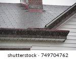 heavy rain with house shingle... | Shutterstock . vector #749704762