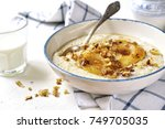 oat porridge with caramelized... | Shutterstock . vector #749705035