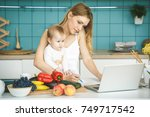 young mother smiling  cooking... | Shutterstock . vector #749717542
