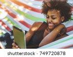 cute cheerful teenage brazilian ... | Shutterstock . vector #749720878