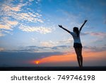 silhouette of free woman... | Shutterstock . vector #749746198