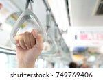 close up hand women holding... | Shutterstock . vector #749769406