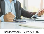 entrepreneur calculate... | Shutterstock . vector #749774182