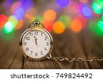 new year's clock at midnight | Shutterstock . vector #749824492