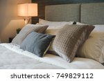 gray and brown pillow on bed...   Shutterstock . vector #749829112