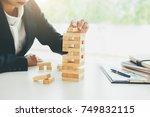 hand of business man planning ... | Shutterstock . vector #749832115
