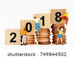 miniature people with coins... | Shutterstock . vector #749844502