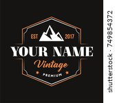 vintage logo with mountain... | Shutterstock .eps vector #749854372