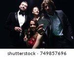 upper class friends gambling in ... | Shutterstock . vector #749857696
