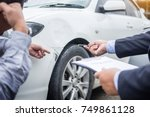 insurance agent writing on... | Shutterstock . vector #749861128