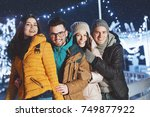 young people outdoors having... | Shutterstock . vector #749877922