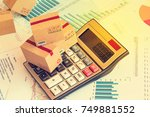 packaging boxes and calculator... | Shutterstock . vector #749881552