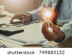 hand man accountant holding... | Shutterstock . vector #749885152