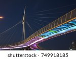 Beautiful bridge in the shape of a sail at sunset in Petah Tikva. Israel.