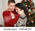 young couple together with... | Shutterstock . vector #749948752