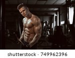 man sports in the gym.guy in... | Shutterstock . vector #749962396