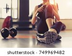 woman exercise workout in gym... | Shutterstock . vector #749969482