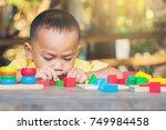 boy intend to build... | Shutterstock . vector #749984458