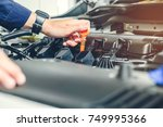mechanic changing oil mechanic... | Shutterstock . vector #749995366