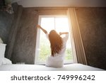 wake up  woman in the morning... | Shutterstock . vector #749996242