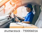 young handsome delivery man... | Shutterstock . vector #750006016