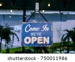 open sign banner in front of... | Shutterstock . vector #750011986