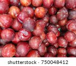 A Pile Of Fresh Plum To Be Sol...