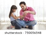 father pouring coins from money ... | Shutterstock . vector #750056548