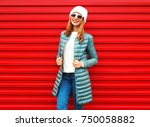 fashion smiling woman on a red... | Shutterstock . vector #750058882