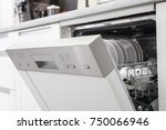 open dishwasher with clean... | Shutterstock . vector #750066946