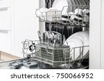 open dishwasher with clean... | Shutterstock . vector #750066952